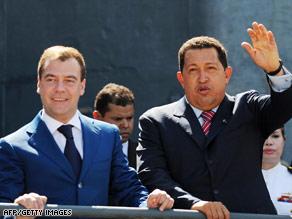 Russian President Dmitri Medvedev, left, and Venezuela's Hugo Chavez visit an anti-submarine vessel Thursday.