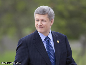 "Prime Minister Stephen Harper accuses coalition leaders of ""betrayal"" by relying on Quebec separatists' support."