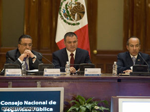 Mexican President Felipe Calderon, at right, spoke at the National Public Security Session last month.