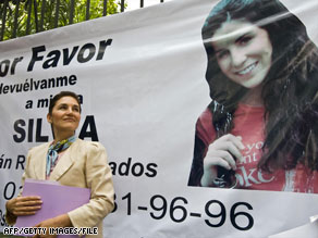 Silvia Escalera stands next to a banner asking for the release of her daughter in Mexico City in August.