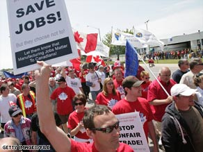 Canadian autoworkers rally last June outside a General Motors plant in Oshawa, Ontario.