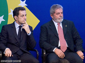 French President Nicolas Sarkozy, left, and Brazilian President Luiz Inacio Lula da Silva meet Monday.