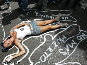 A chalk message reads No More Murders as a student protests  killings in Caracas in this file photo.