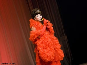 Teacher Zhang shows off his impressive drag wardrobe at home.