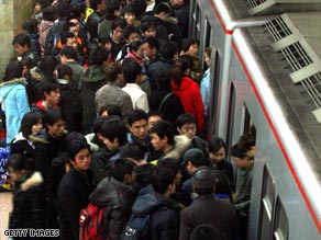A passenger fights his way out of a subway station in Beijing during rush hours.