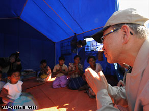 Ban Ki-moon makes a traditional gesture to a displaced family in the Kyondah village Thursday.