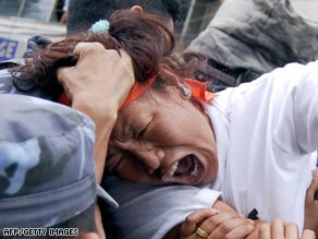 A protester is grabbed by Nepalese police during a demonstration in Kathmandu.