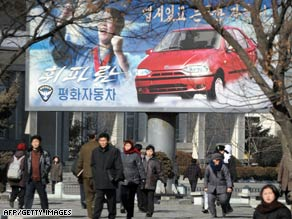 Commuters head to work in downtown Pyongyang this past February.