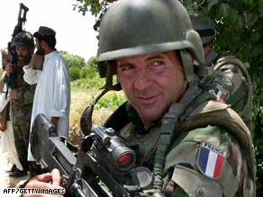A French NATO soldier stands guard in the Arghandab district of Afghanistan's Kandahar province on Friday.