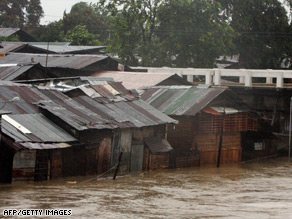 Homes in the city of Iloilo have been flooded after the arrival of Typhoon Fengshen.