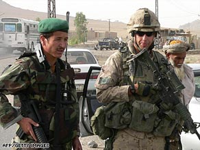 An Afghan and Canadian soldier man a checkpoint near Kandahar, in southern Afghanistan.