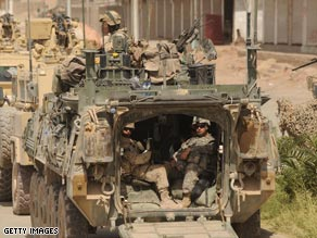 NATO soldiers sit in their vehicle in an Afghan province freed from Taliban forces.