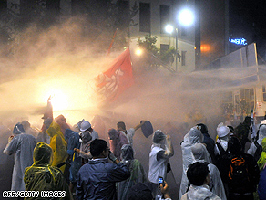 Police use a water cannon to disperse protesters during a rally against U.S. beef imports in Seoul on Sunday.