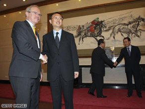 Delegates, includijng U.S. Assistant Secretary of State Christopher Hill, left, at a meeting on July 12 in Beijing.
