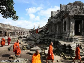 Cambodian Buddhist monks walk at Preah Vihear temple on Monday.