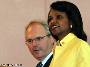 Diplomats Condoleezza Rice and Christopher Hill walk between meetings Wednesday in Singapore.