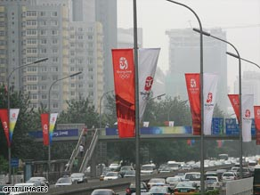 A sign pointing to special Olympic vehicle lanes stands out in the smog on Sunday in Beijing.