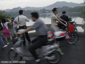 Ying Ying Joyce Choi, right on red bike, is both citizen and foreigner as she rediscovers China.