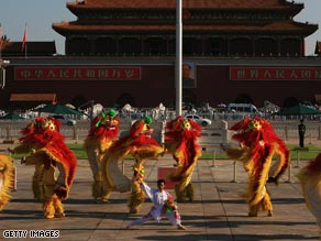 Dancers perform the traditional lion dance at Tiananmen Square in Beijing in early August.