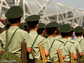 Chinese soldiers patrol near the National Stadium in Beijing.