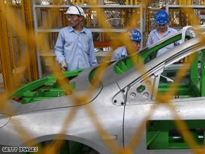 Workers at a factory for the Chery Automobile Co. in mid-July in Anhui province, China.
