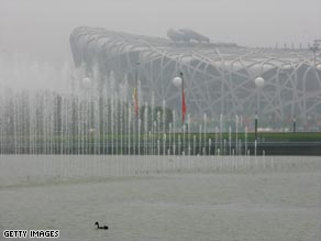 The National Stadium, known as the Bird&#039;s Nest, is shrouded in smog on opening day of the 2008 Olympics. 