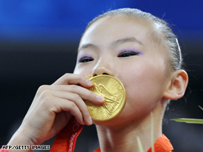 China's He Kexin kisses her gold medal last week after winning the Olympic women's uneven bars.