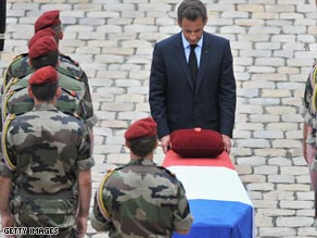 President Sarkozy pays tribute to the fallen troops at a  ceremony in Paris.