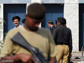 Police and authorities investigate the scene of the arms factory blast in Wah, near Rawalpindi.