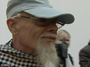 Gary Glitter pictured on his arrival at London's Heathrow airport on Friday.