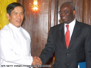 Myanmar Foreign Minister Nyan Win and U.N. envoy Ibrahim Gambari shake hands in Yangon last Monday.