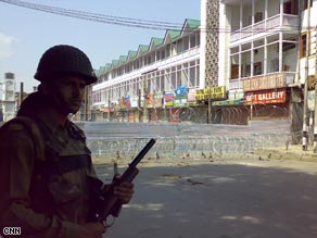 The city centre of Lal Chowk, sealed off by tin sheets and razor fitted wire by  Indian paramilitary forces Monday.