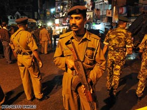 Police cordon off a street in Colombo on Monday following an explosion that injured at least 10.