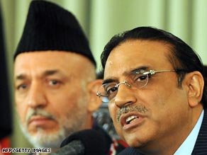 Afghanistan's Hamid Karzai, left, and Pakistan's Asif Ali Zardari have pledged to work together.
