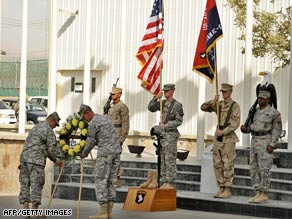 Soldiers at a U.S. base in Afghanistan on Thursday honor the victims of September 11, 2001.