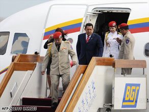 Venezuelan President Hugo Chavez, center, arrives in Beijing at the start of an official visit on Tuesday.