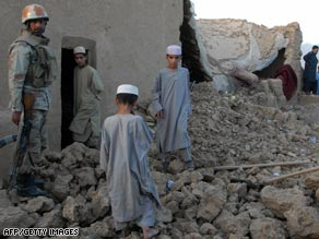 Pakistani soldier stands guard at site of destroyed Islamic school after a bomb blast near Quetta on Friday.