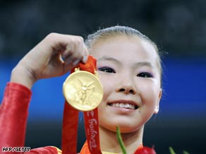 Widespread reports claimed that gold medal winner  He Kexin was only 14 years old.