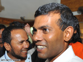 Mohamed Nasheed, right, shakes hands with supporters after he emerged winner of the presidential election.