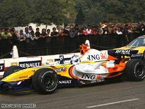 A Renault Formula 1 car performs during a roadshow in New Delhi, India, on November 9.
