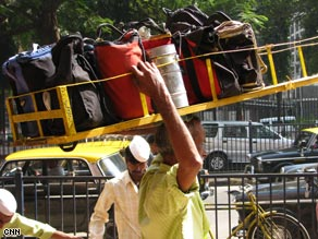 Manish Tripathi is responsible for bringing some parta of the dabbawala operation into at least the 20th century.