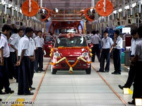 The Spark car rolls out of General Motors' new plant in Pune, India, on September 2.