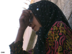 Banafsha, learning in a center run by Aschiana, an Afghan NGO, says she wants to become a teacher.