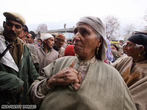 Kashmiri Muslims queue outside a polling station in Bandipore, south of Srinagar, on Monday.