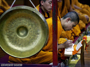 Tibetan monks in exile pray at a temple in Dharamsala, India, on Sunday.
