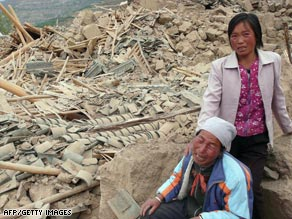 Farmers grieve in front of their destroyed property in the aftermath of the May 2008 earthquake.