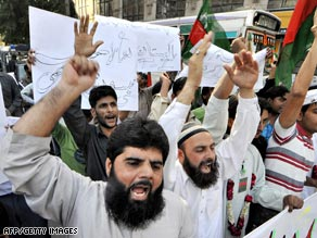 Activists shout slogans during an anti-US protest rally in Karachi on Thursday.