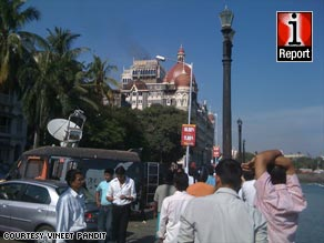 Vineet Pandit, 22, ventured as close to the burning Taj Mahal hotel as he could on Thursday to snap this photo.