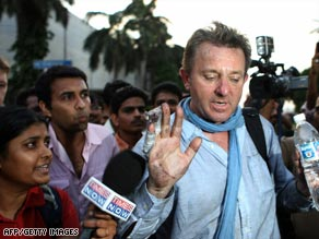 A foreign national held hostage by gunmen for nearly 24 hours is released from the Oberoi hotel in Mumbai.