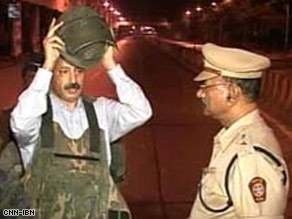 Hemant Karkare, left, was killed by gunmen in Mumbai shortly after this video was taken Wednesday.